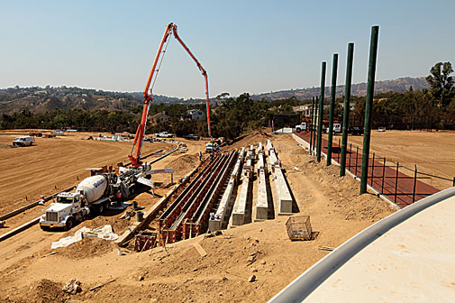 Crews install seating at the track and field/soccer complex.