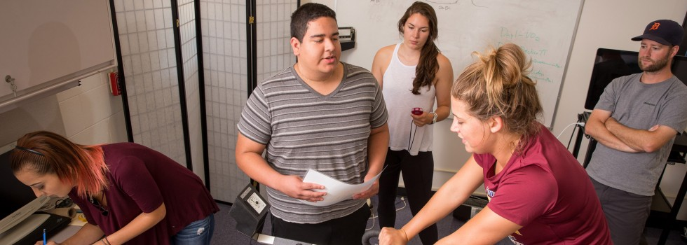 Student researchers Danielle Costa, Tyler Salinas and Sarah McGough work with Dr. Tim Van Haitsma to evaluate student Jae Ferrin