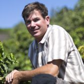 Jay Ruskey with one of his coffee plants (photo by Michelle Nunes)