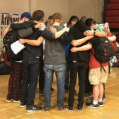 Students pray at Murchison Gym ahead of the campus evacuation (photo by Edee Schulze)