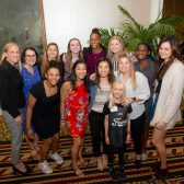 The Westmont women's basketball team poses with Tamika Catchings